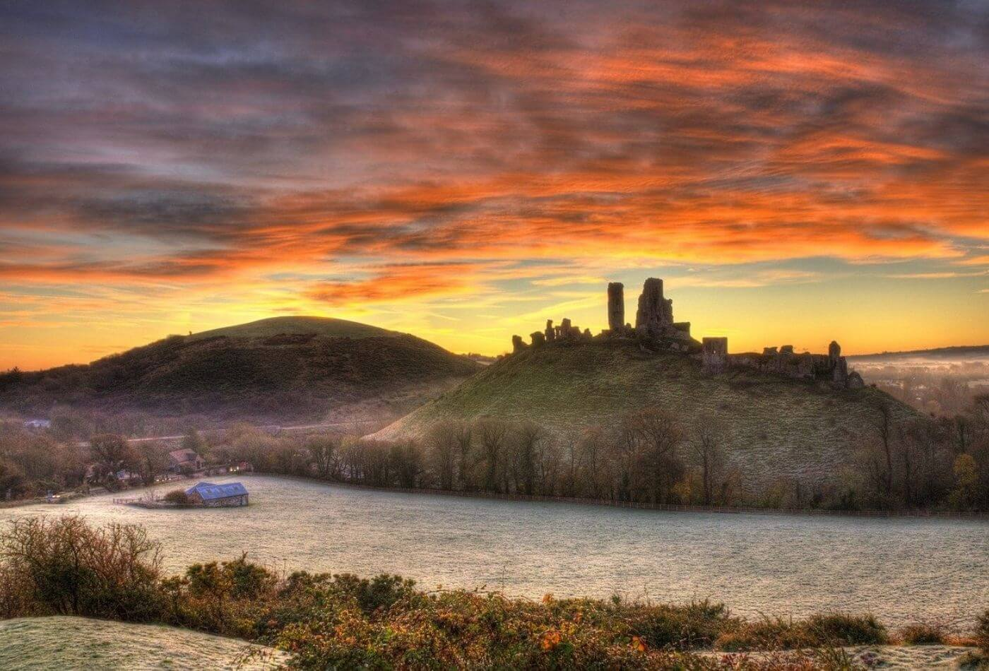 A scenic sunset over corfe castle, a popular dorset attraction