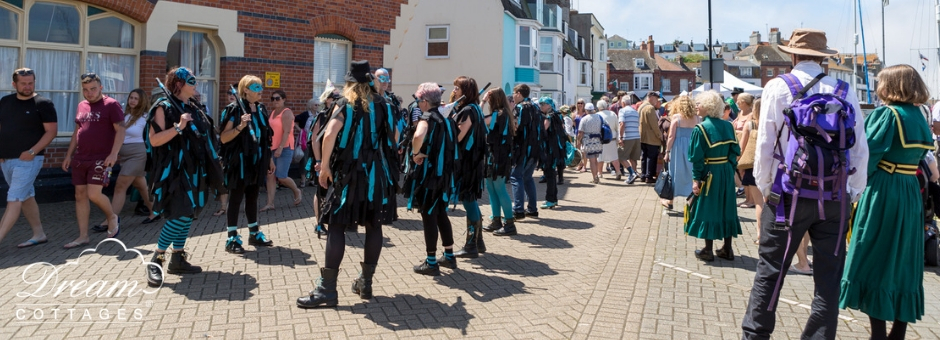 Wessex Folk Festival dancers along the harbour in Weymouth