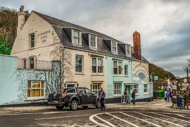 Lulworth Cove Inn with customers outside