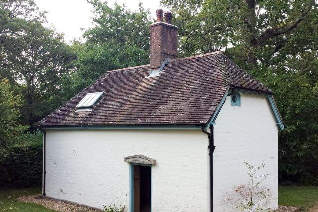 White exterior of Clouds Hill cottage in Dorset